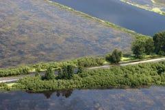 Inundación, baterías del desbordamiento del río e inundación Imágenes de archivo libres de regalías