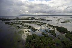 Inundación con áreas inundadas Imagenes de archivo
