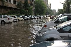 Inundation. Cars in big water flood in Bucharest, after the rain. Picture taken  in 05.05.2014 Stock Images