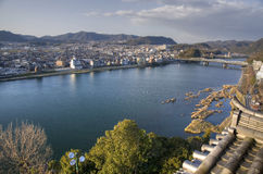 Inuyama city, Japan. Inuyama-shi with Kiso river and mountains on background, Japan Stock Photos