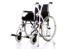 Invalid chair, wheelchair and crutches- Royalty Free Stock Photo