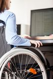 Invalid or disabled woman sitting wheelchair working office desk computer Stock Photos