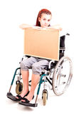 Invalid girl on wheelchair with cork board Royalty Free Stock Photo