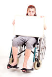 Invalid girl on wheelchair with whiteboard Royalty Free Stock Photography