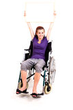 Invalid girl on wheelchair with whiteboard Royalty Free Stock Images