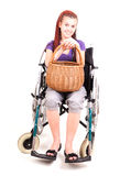 Invalid girl on wheelchair with wicker basket Stock Images