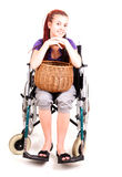 Invalid girl on wheelchair with wicker basket Royalty Free Stock Photos