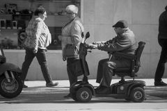 Free Invalid Old Man Ion His Scooter Royalty Free Stock Images - 114650269