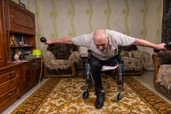 Invalid old man leaned and doing exercises Royalty Free Stock Photography