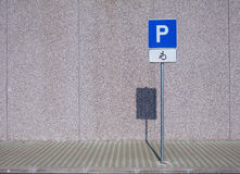Invalid people sign. Sign on the public parking place for invalid people cars Royalty Free Stock Image