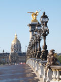The Invalides from the Alexander III bridge, Paris. View from the Alexander III bridge over the Seine in Paris, France. In background the Invalides palace Royalty Free Stock Images