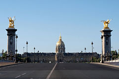 The Invalides from the Alexander III bridge, Paris. View from the Alexander III bridge over the Seine in Paris, France. In background the Invalides palace Stock Photo