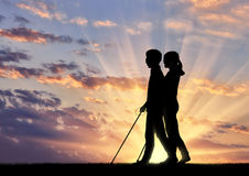 Invalids blind with cane go sunset Royalty Free Stock Photography