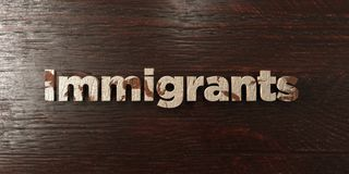 Invandrare - grungy trärubrik på lönn - 3D framförd fri materielbild för royalty vektor illustrationer