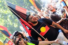 Invasion Day Australia Day Protests in Melbourne. MELBOURNE, AUSTRALIA – JANUARY 26: Indigenous rights protesters marching in the CBD during the Invasion Day Royalty Free Stock Photo
