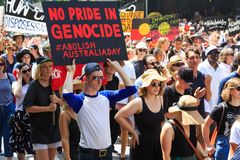 Invasion Day Australia Day Protests in Melbourne. MELBOURNE, AUSTRALIA – JANUARY 26: Indigenous rights protesters marching in the CBD during the Invasion Day Stock Photo