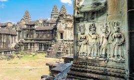 Invecklade carvings på en tempelvägg i Siem Reap, Kambodja 3 Arkivfoto