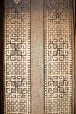 Invecklat snöra åt gardinen royaltyfri bild