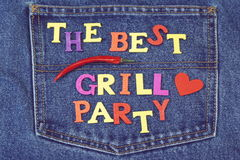 Inventation Sign For BBQ Or Grill Party On Jeans Background Stock Photo