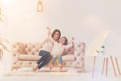 Inventive artistic mom entertaining her kid stock photography