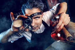 Inventor. Portrait of a crazy medieval scientist working in his laboratory. Alchemist. Halloween stock images