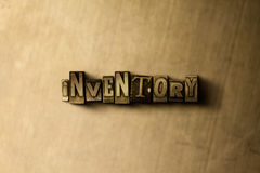 INVENTORY - close-up of grungy vintage typeset word on metal backdrop Royalty Free Stock Images