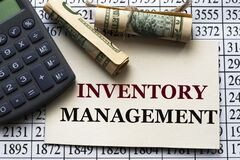 Free INVENTORY MANAGEMENT - Words On White Paper Against The Background Of A Table Of Numbers With A Calculator And Banknotes Royalty Free Stock Images - 215015659