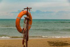 Free Inventory Of Rescuers On The Beach. Lifebuoy On The Beach. Stock Images - 126677724
