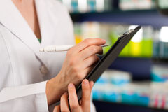 Inventory or order taking in pharmacy Stock Image