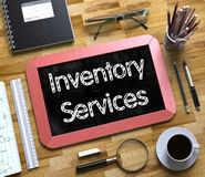 Inventory Services on Small Chalkboard. 3D. Stock Photos
