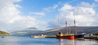 Inveraray harbour in Scotland, with two Vintage boats docked Stock Photos