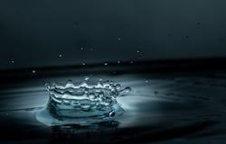 Inverkan för vattendroppfärgstänk royaltyfri fotografi