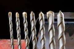 Inverkandrillborr, konkret borranderigg Tabell i ett mekaniskt seminarium royaltyfri bild