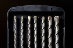 Inverkandrillborr, konkret borranderigg Tabell i ett mekaniskt seminarium fotografering för bildbyråer