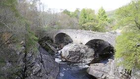 Invermoriston bridge Scottish tourist attraction built by Thomas Telford in 1813 to cross the River Moriston stock video footage