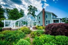 Invernadero y casa en Elizabeth Park, en Hartford, Connecticut imagen de archivo