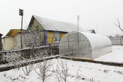 Invernadero y nieve Imagen de archivo libre de regalías