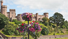 Inverness Castle. Baskets of colorful flowers in front of historic Inverness Castle, now used as a Sheriff court Royalty Free Stock Images