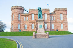 Inverness Castle from the West. An image of Inverness Castle viewed from its main approach road in the west and showing a monument to Flora MacDonald Royalty Free Stock Photo