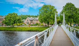 Infirmary Bridge in Inverness on a summer morning, Scottish Highlands. Inverness is a city on Scotland's northeast coast, where the River Ness meets the Moray Stock Photo