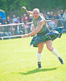 Inverness Highland Games. Competitor throwing the weight competition at Inverness Highland Games on 20th July 2013 Royalty Free Stock Photo