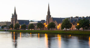 Inverness River Ness Scotland. Reflections of church spires  on the River Ness, in the city of Inverness capital of the Highlands of Scotland during a sunset Royalty Free Stock Image