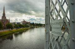 Inverness view from footbridge on Ness river, cloudy day Scotlan Royalty Free Stock Photo