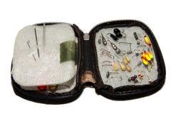 Inverno che pesca maschera in una borsa del sacchetto Isolato su priorità bassa bianca immagine stock