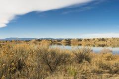 Inverno del pueblo del lago metà di fotografia stock libera da diritti
