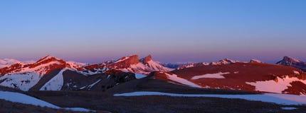 Inverno di tramonto della montagna Immagine Stock