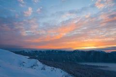 Inverno di tramonto della montagna Fotografie Stock Libere da Diritti