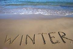 inverno escrito na areia molhada Imagem de Stock Royalty Free