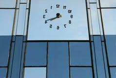 Inverse clock blue background. Inverse glass clock blue background during the day royalty free stock photo
