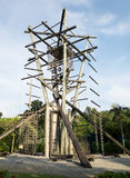 Inverse tower challenge. Inverse tower rope course at the Outward Bound School in Pulau Ubin, Singapore royalty free stock image